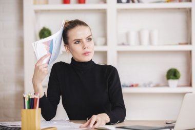 Concentrated female doing paperwork