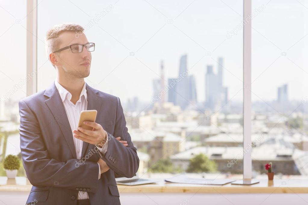portrait of businessman with smartphone stock photo peshkova