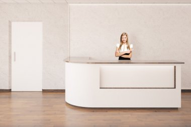 Young businesswoman at reception desk