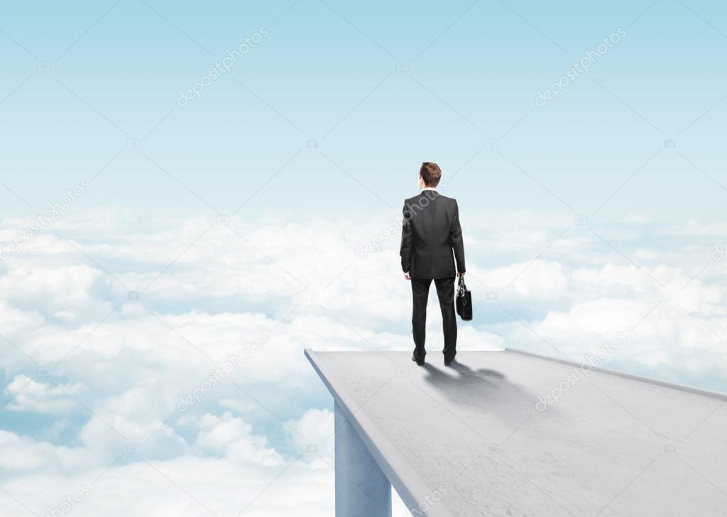 businessman standing on pier