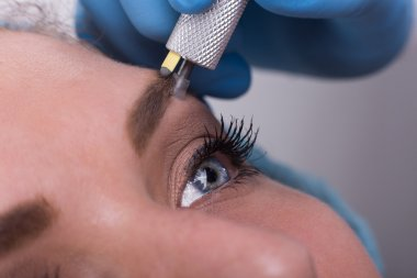 Young woman getting a permanent eyebrow make up treatment