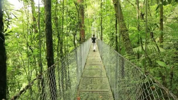 Woman on hanging bridge, Costa Rica