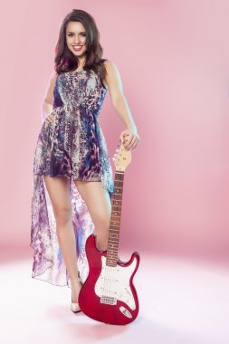 Fashion girl with guitar.