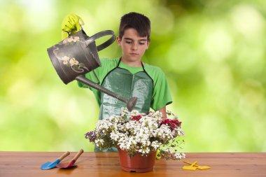 Child with garden plants