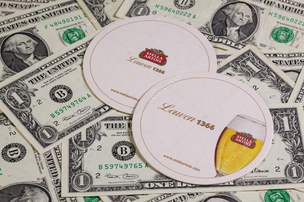 Beermats from Stella Artois and US dollars.