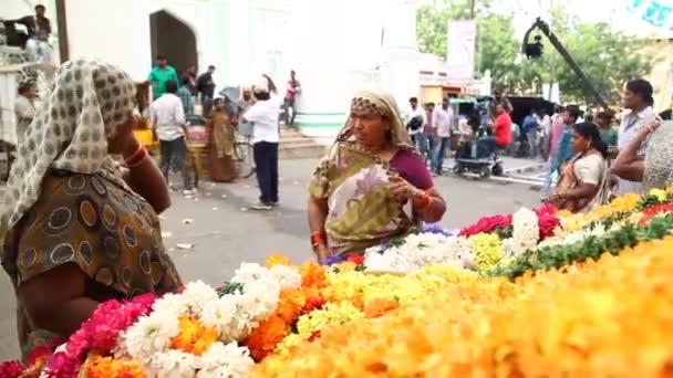 Poor people at street market