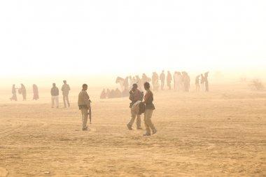 Men with guns in Desert
