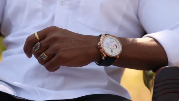 hand with watch and rings