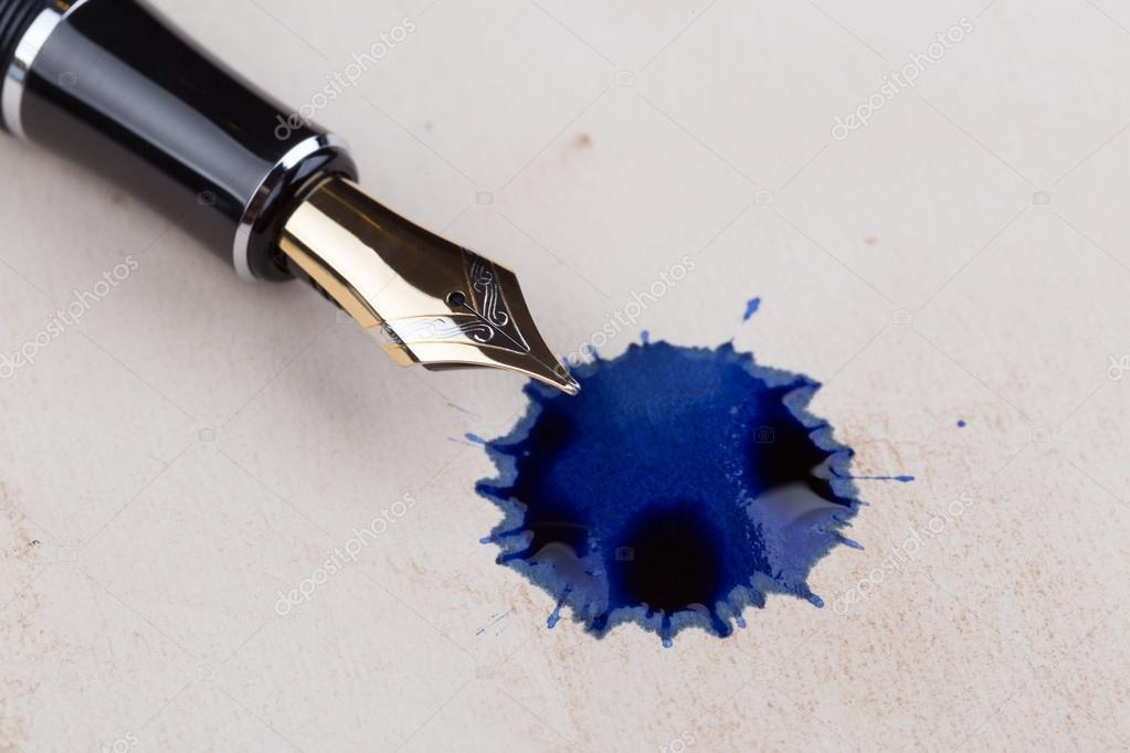 https://br.depositphotos.com/89031948/stock-photo-old-fountain-pen-with-blots.html