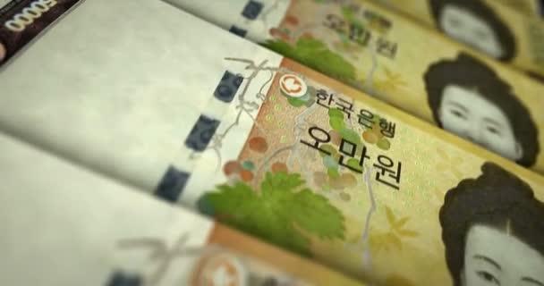 Südkorea gewann die Banknotenschleife. KRW Geld Textur. Konzept der Wirtschaft, Wirtschaft, Krise, Banken, Rezession, Schulden und Finanzen. Über den Zettel gehen. Nahtlose 3D-Animation.