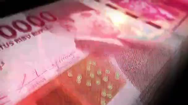 Indonesische Rupiah-Banknotenschleife. IDR Geld Textur. Konzept der Wirtschaft, Wirtschaft, Krise, Banken, Rezession, Schulden und Finanzen in Indonesien. Über den Zettel gehen. Nahtlose 3D-Animation.