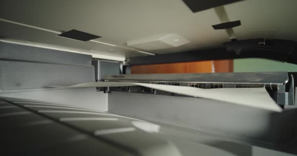 Zavřít. Office laser jet printer printing a pages paper.