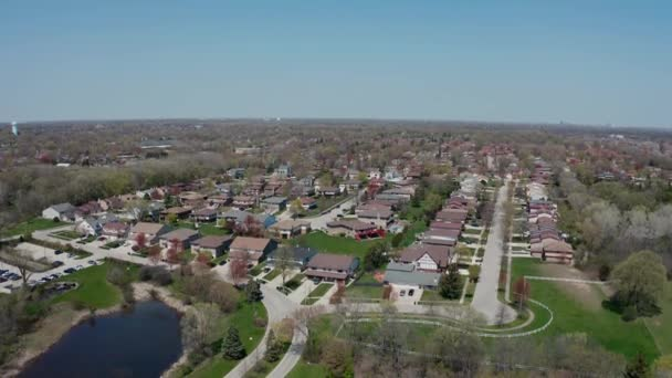 Aerial drone view of american suburb at summertime. Establishing shot of american neighborhood. Real estate, top down view of residential houses. Drone shot, from above
