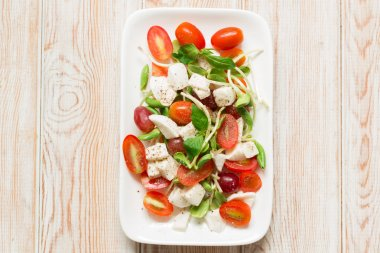 salad with mozzarella, tomato, basil