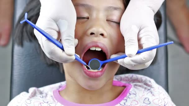 HD Footage close up of Dentist cleaning teeth and checking with plaque remover tool