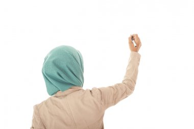 Back view of muslimah business woman writing something on white