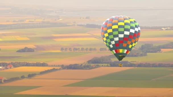 Hot air balloon flying over Dutch landscape