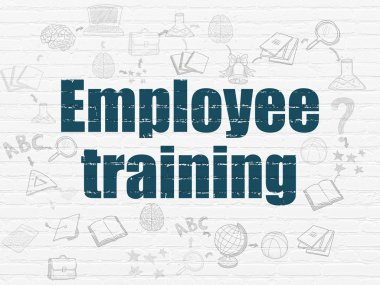 Learning concept: Employee Training on wall background