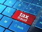 Fotografie Law concept: Tax Fraud on computer keyboard background