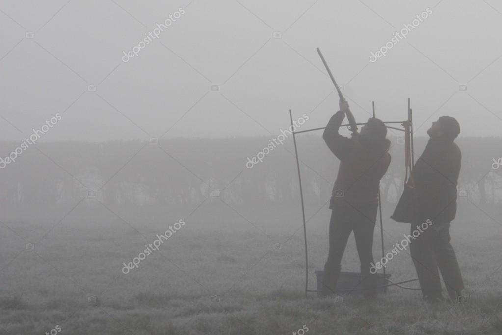 Clay pigeon shooting on a misty day
