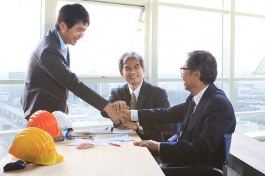 business man shaking hand after successful project solution plan