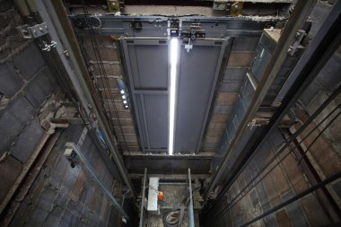 Inside of roping Elevator, Lift box builting in high building sh