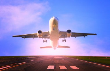 Passenger jet plane take off from airport runway
