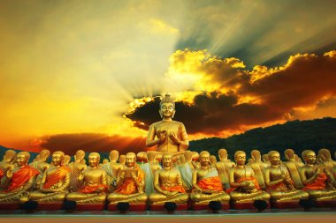 golden buddha statue in buddhism temple thailand against dramati
