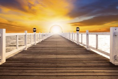 Sun set scene and old wood bridge pier with nobody against beaut