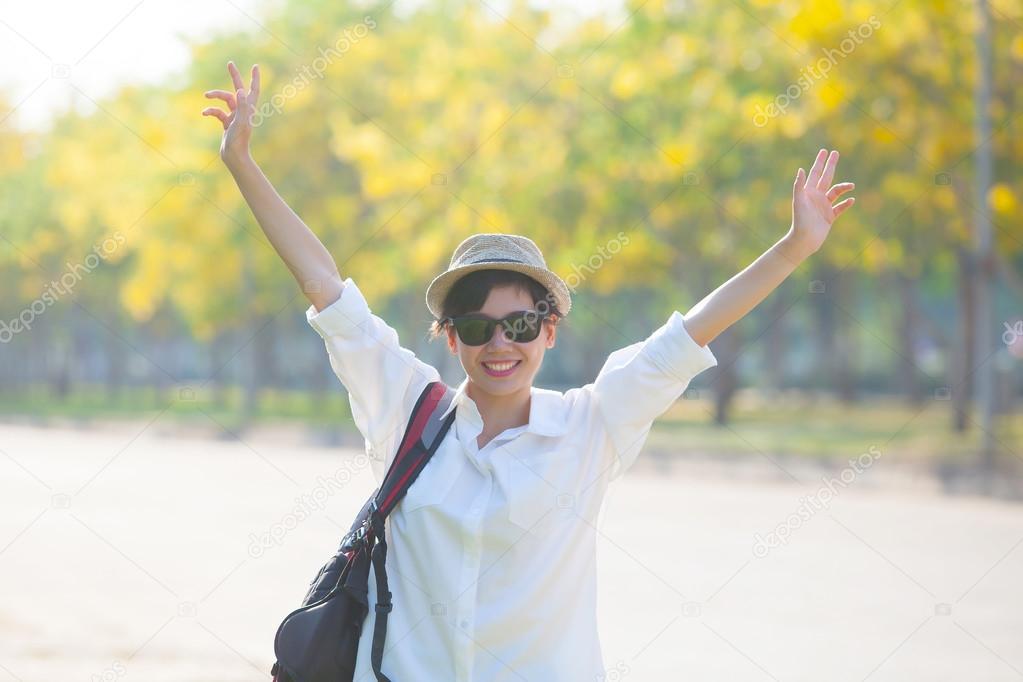 young beautiful woman wearing white shirts ,straw hat and sun gl