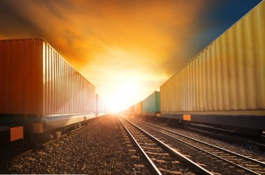 industry container trainst running on railways track against bea