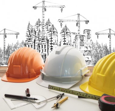 safety helmet on architect ,engineer working table with modern b
