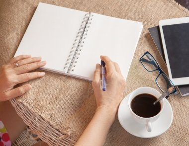 woman writing shot memories note on white paper with relaxing ti