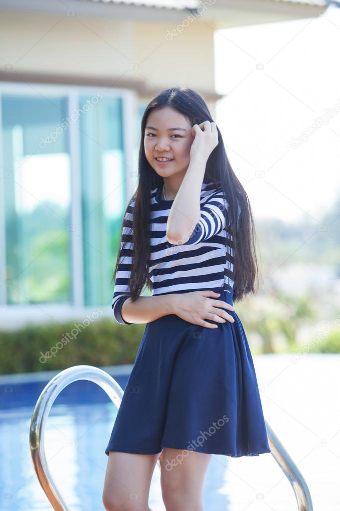 Portrait Of Young Asian Teen Smiling Face Happiness Emotion At H Stock Photo