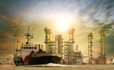 gas lpg tanker ship in river port and oil refinery background