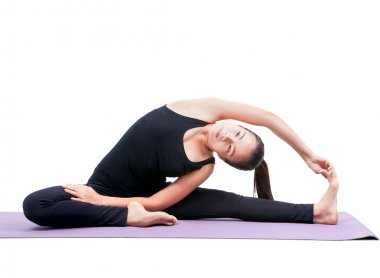 portrait of asian woman wearing black body suit sitting in yoga