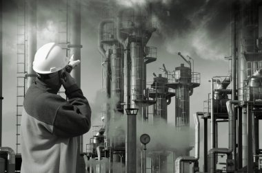 Oil and gas worker in hard-hat pointing at industrial refinery, smoke and smog stock vector