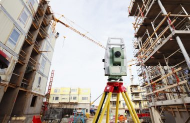 Surveyors instrument inside construction plant