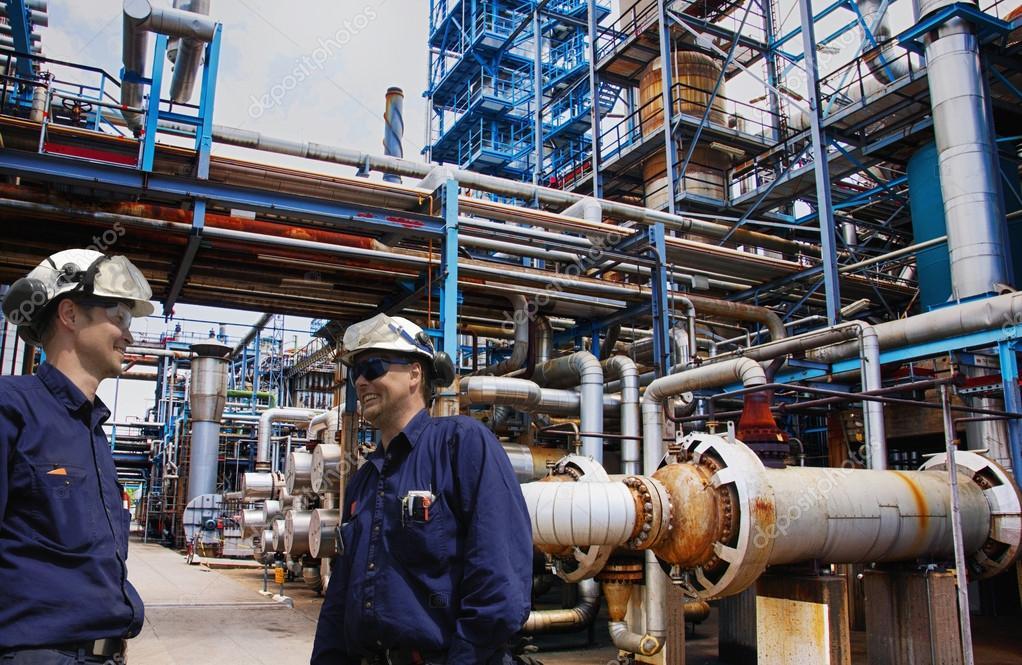 Oil workers inside industrial oil refinery