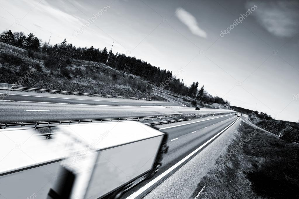 Trucking on long straight of highway