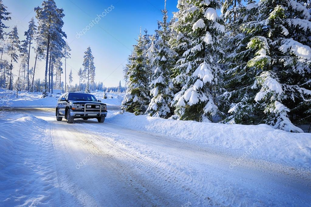 Suv, car driving in rough snowy terrain
