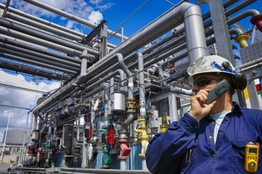 Oil and gas industrial workers and refinery