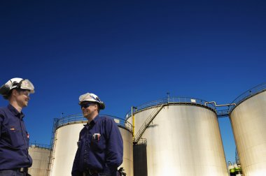 oil workers and fuel storage tanks