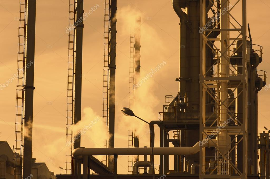 oil and gas refinery at sunset