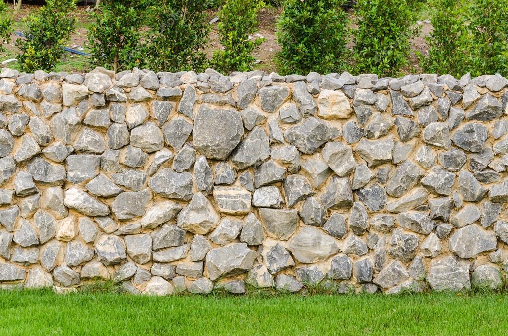 Mur de cl ture pierre v ritable surface avec du ciment sur - Monter un mur en pierre avec du ciment ...