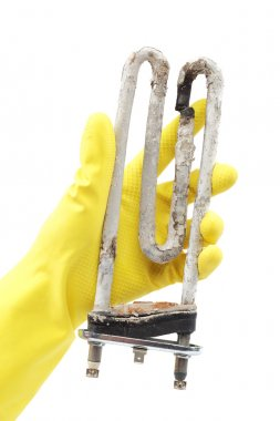Damaged heating element of the washing machine in hand with rubb