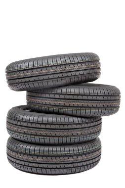 Car tires on white background.