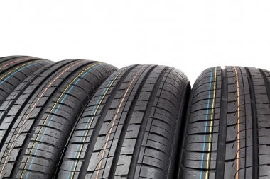 Car tires on white background.