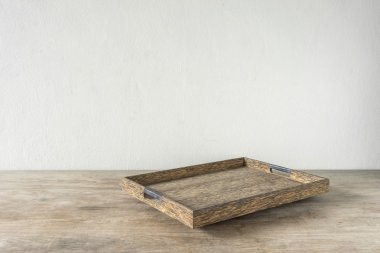 Wooden tray on wooden table