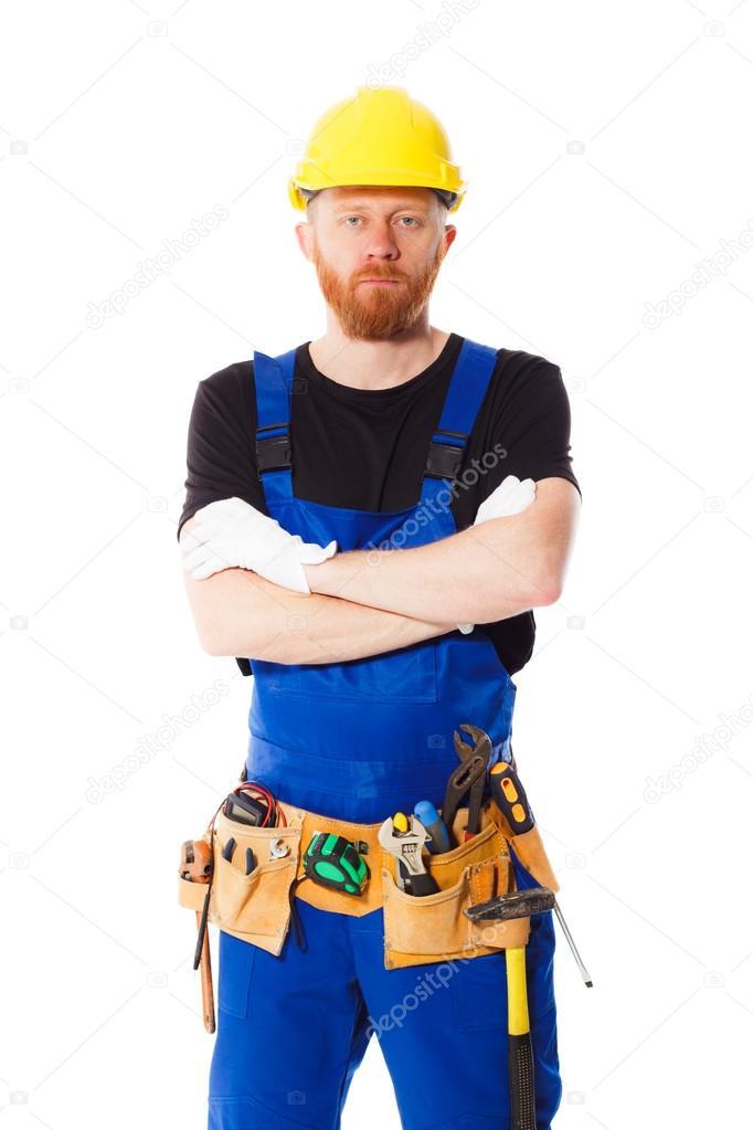 9c64717e6145 Constructeur dans la ceinture de cuir et casque de construction d outils de  construction différents, isolés — Image de kazatin